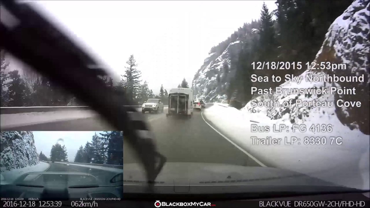 Dangerous Overtaking by a Trailer-Hauling Bus Captured on Dashcam